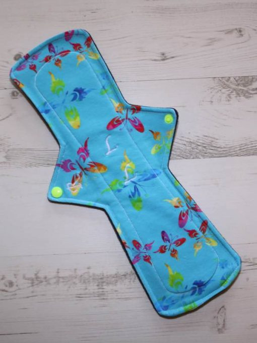 14″ Regular Flow cloth pad | Rainbow Butterflies Cotton Jersey | Indigo Wind Pro Fleece | Luna Landings | Double Flare 1