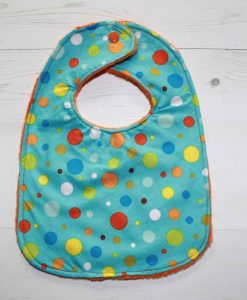 rear-snap-baby-bib-rainbow-dot-cotton-and-orange-plush_1