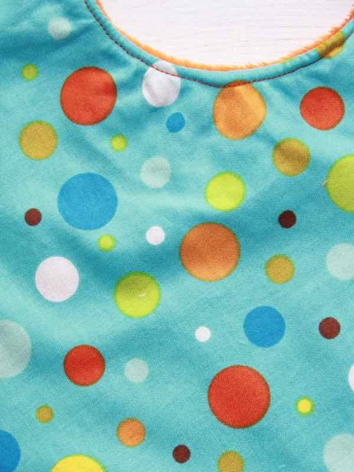 rear-snap-baby-bib-rainbow-dot-cotton-and-orange-plush_2