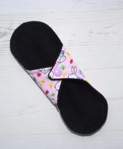 8″ Light Flow cloth pad | Bunnies on Pink Cotton | Black Organic Cotton Fleece | Luna Basics | Sub