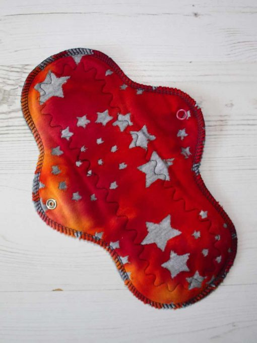 10-inch-Regular-Flow-cloth-menstrual-pad-Stars-on-Red-Ombre-Cotton-Jersey-and-Navy-Polar-Fleece-Aunt-Irma's-Curvy-Moonglow_1