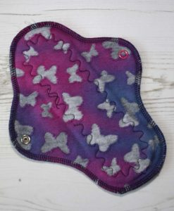 8-inch-Regular-Flow-cloth-menstrual-pad-Purple-Butterflies-Cotton-Jersey-and-Navy-Polar-Fleece-Aunt-Irma's-Curvy-Moonglow_1