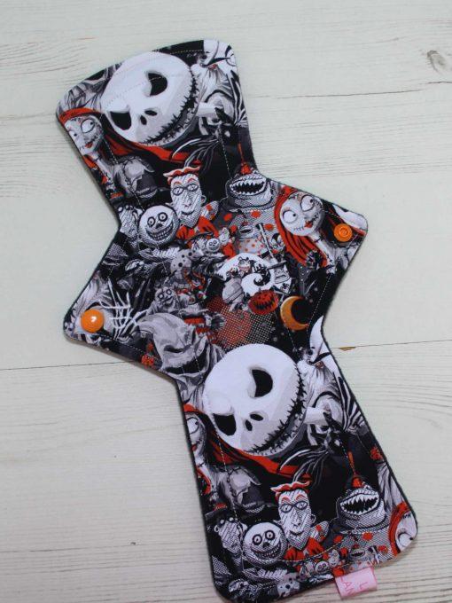 """12"""" Heavy Flow cloth pad   Pumpkin King Cotton Jersey   Black Wind Pro Fleece   Luna Landings   Double Flare"""